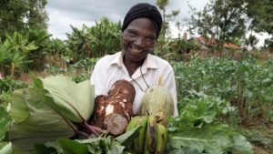Eunice proudly shows produce from her farm Photo: © Biovision Peter-Luthi